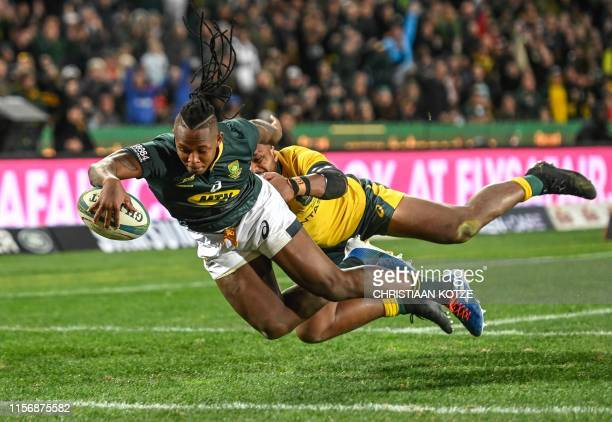 South Africa's S'busiso Nkosi scores his try despite the opposition of Australia's Samu Kerevi during the 2019 Rugby Championship match South Africa...