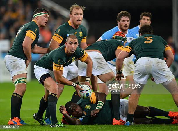 South Africa's scrum half Ruan Pienaar passes the ball during the bronze medal match of the 2015 Rugby World Cup between South Africa and Argentina...