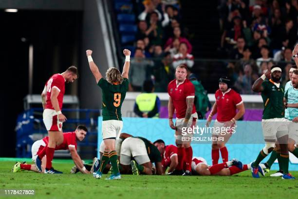 South Africa's scrumhalf Faf de Klerk celebrates after South Africa's centre Damian De Allende scored a try during the Japan 2019 Rugby World Cup...