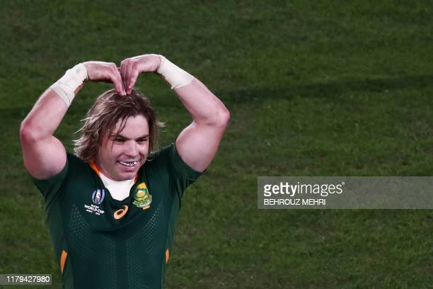 South Africa's scrum-half Faf de Klerk gestures as he celebrates winning the Japan 2019 Rugby World Cup final match between England and South Africa...