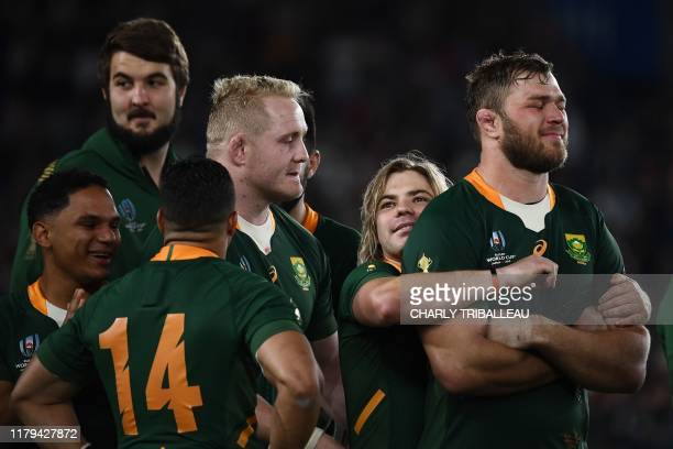 South Africa's scrumhalf Faf de Klerk hugs South Africa's number 8 Duane Vermeulen as they celebrate winning the Japan 2019 Rugby World Cup final...