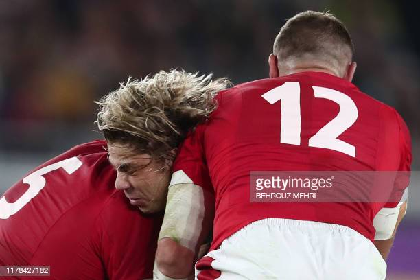 TOPSHOT South Africa's scrumhalf Faf de Klerk is tackled by Wales' lock Alun Wyn Jones and Wales' centre Hadleigh Parkes during the Japan 2019 Rugby...