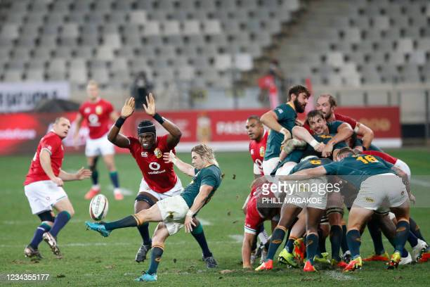 South Africa's scrum-half Faf de Klerk kicks the ball challenged by British and Irish Lions' lock Maro Itoje during the second rugby union Test match...