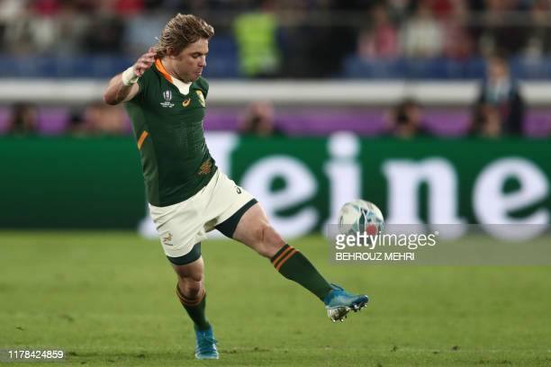 South Africa's scrumhalf Faf de Klerk kicks the ball during the Japan 2019 Rugby World Cup semifinal match between Wales and South Africa at the...