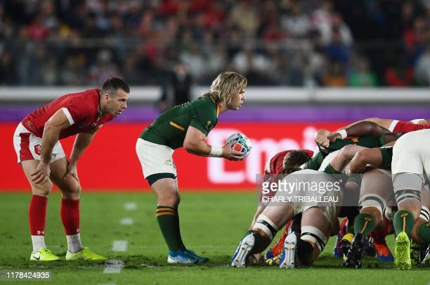 TOPSHOT South Africa's scrumhalf Faf de Klerk prepares to feed the ball into a scrum during the Japan 2019 Rugby World Cup semifinal match between...