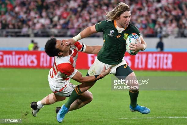TOPSHOT South Africa's scrumhalf Faf de Klerk scores a try during the Japan 2019 Rugby World Cup quarterfinal match between Japan and South Africa at...