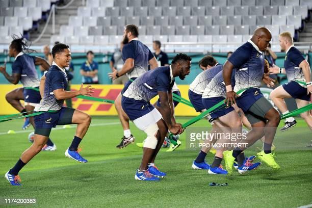 South Africa's scrum-half Hershel Jantjies , back row Siya Kolisi and hooker Bongi Mbonambi take part in a captain's run training session at the Kobe...