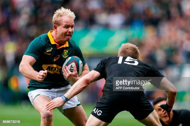 South Africa's scrumhalf Ross Cronje challenges New Zealand's flyhalf Damian McKenzie during the Rugby test match between South Africa and New...