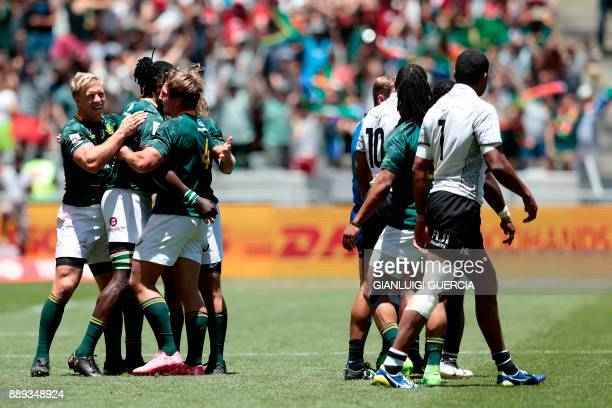 South Africa's Sevens team players celebrates after beating Fiji in their quarterfinal match on the second day of the World Rugby Sevens Series at...