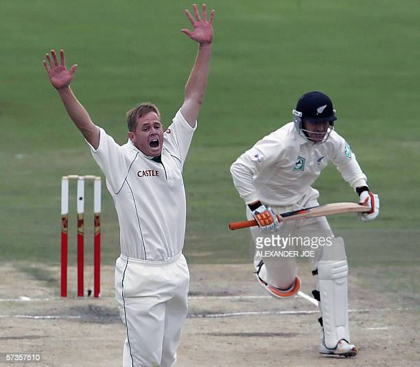 South Africa's Shaun Pollock, makes unsuccessful appeal on New Zealands batsman Daniel Vettori before bad light stopped play during New Zealand's 2nd...
