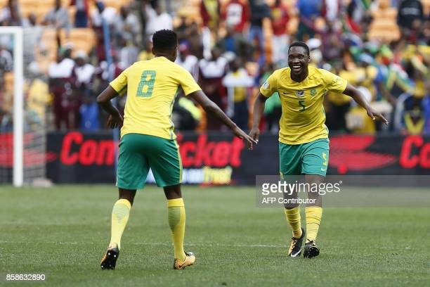 South Africa's Sibusiso Vilakazi celebrates his goal with his teammate Bongani Zungu during the World Cup 2018 qualifier football match between South...