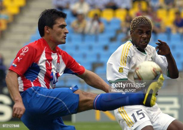 South Africa's Sibusiso Zuma challenges Paraguay's Roberto Acuna for the ball 02 June 2002 during their Group B match in Busan AFP PHOTO / Pascal...