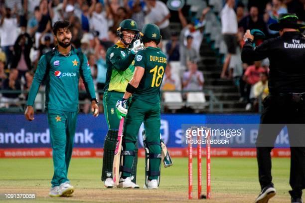 South Africa's skipper Far du Plessis congratulates Rassie van der Dussen, who hit the winning runs to win their ODI cricket march against Pakistan,...