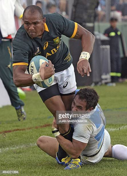 South Africa's Springboks' wing Cornal Hendricks runs through a tackle by Argentina's Los Pumas' fullback Joaquin Tuculet during their Rugby...