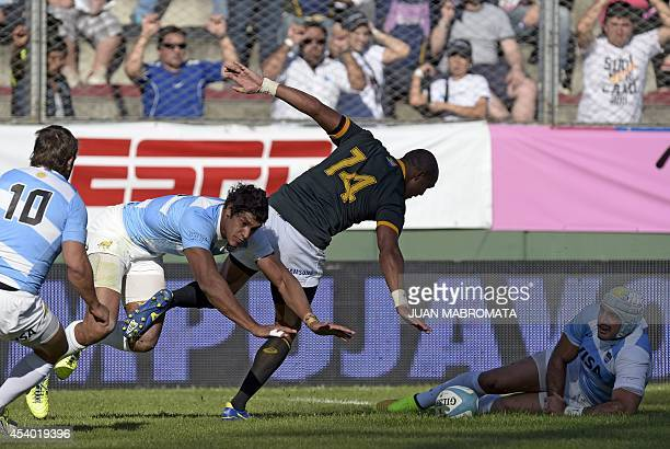 South Africa's Springboks' wing Cornal Hendricks vies for the ball with Argentina's Los Pumas' wing Manuel Montero fly half Nicolas Sanchez and N8...