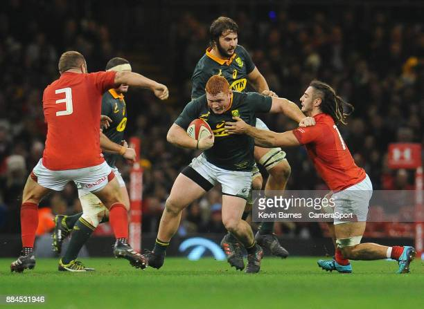 South Africa's Steven Kitshoff is tackled by Wales' Josh Navidi during the 2017 Under Armour Series Autumn International match between Wales and...