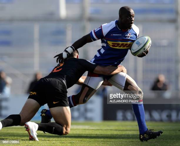 South Africa's Stormers centre JJ Engelbrecht is tackled by Argentina's Jaguares centre Jeronimo De La Fuente during their Super Rugby match at Jose...