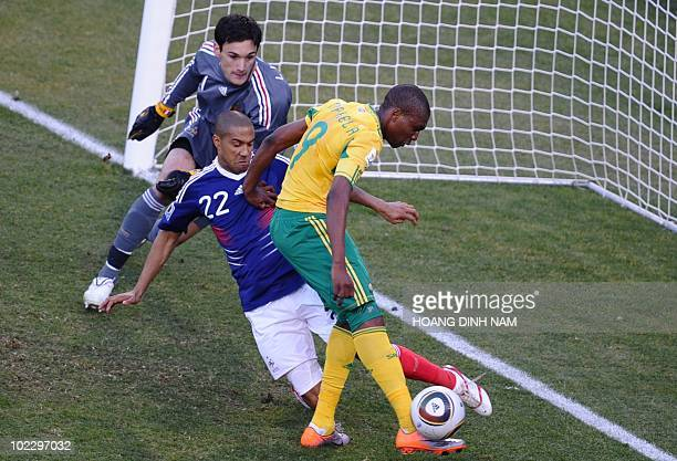 South Africa's striker Katlego Mphela scores past France's goalkeeper Hugo Lloris and France's defender Gael Clichy during the Group A first round...