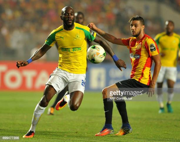 South Africa's Sundowns striker Motjeka Madisha vies with Tunisia's Esperance of Tunis defender Montasser Talbi during the African Champions League...