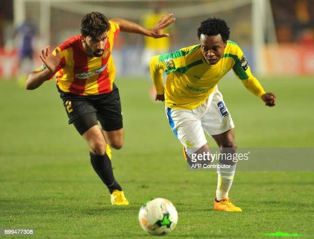 South Africa's Sundowns striker Percy Tau vies with Tunisia's Esperance of Tunis defender Ali Machani during the African Champions League group stage...