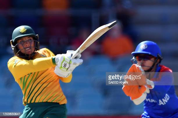 South Africa's Sune Luus plays a shot as Thailand's wicketkeeper Nannapat Koncharoenkai looks on during the Twenty20 women's World Cup cricket match...