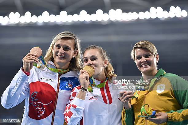 South Africa's Sunette Viljoen Croatia's Sara Kolak and Czech Republic's Barbora Spotakova pose during the podium ceremony for the Women's Javelin...