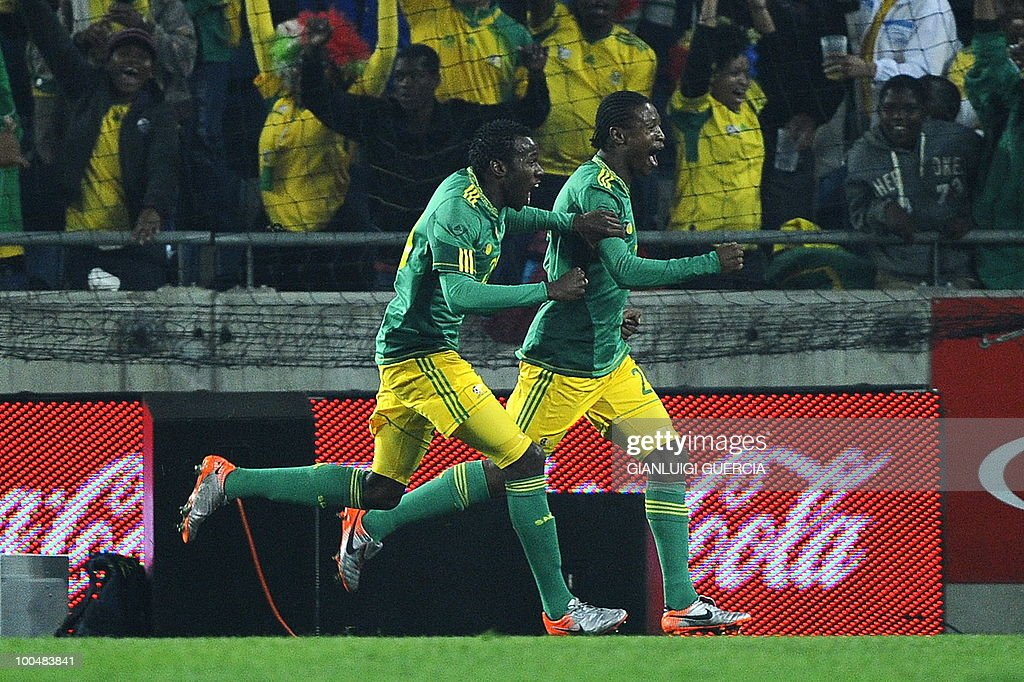 South Africa's Syiabonga Sangweni (R) and Bongani Khumalo(L) celebrate after scoring a goal against Bulgaria during their international friendly football match at the Orlando stadium in Soweto, Johannesburg, on May 24, 2010. The 2010 FIFA World Cup football championship is due to take place in South Africa from June 11 to July 11 of 2010.