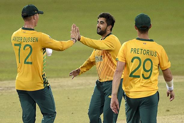 South Africa's Tabraiz Shamsi celebrates with teammates after the dismissal of Sri Lanka's Chamika Karunaratne during the second international...