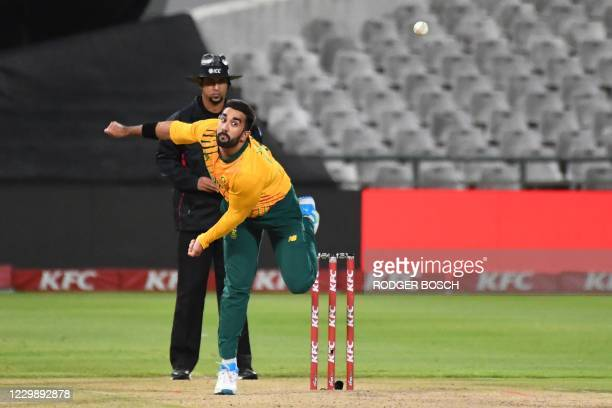 South Africa's Tabraiz Shamsi delivers a ball during the third T20 international cricket match between South Africa and England at Newlands stadium...