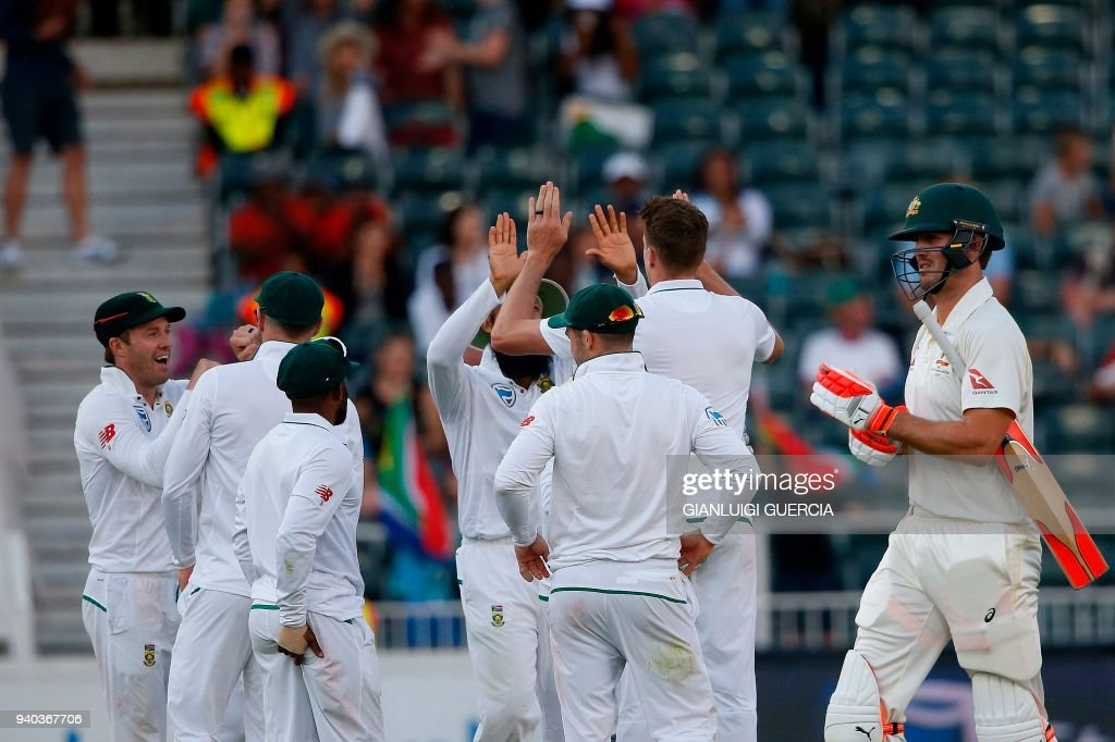 South Africa's team celebrates the dismissal of Australian batsman Mitchell Marsh (R) during the second day of the fourth Test cricket match between South Africa and Australia at Wanderers Cricket Ground on March 31, 2018 in Johannesburg. /