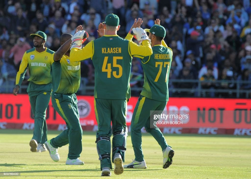 South Africa's team celebrates the dismissal of India's Rohit Sharma's during the third T20I cricket match between India and South Africa at the Newlands Cricket Ground on February 24, 2018 in Cape Town. /