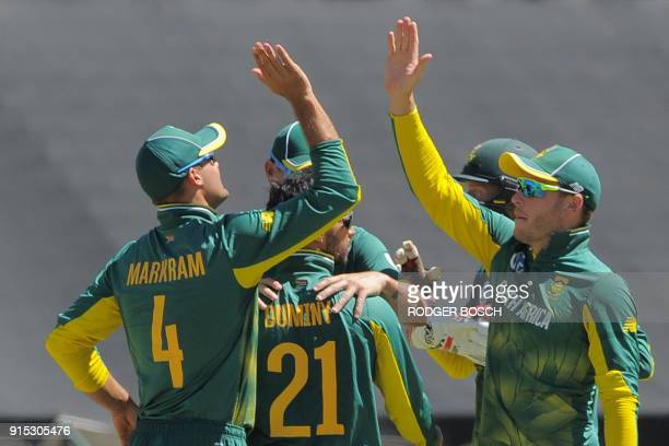 South Africa's team celebrates the dismissal of India's Shikar Dhawan during the One Day International cricket match between India and South Africa...
