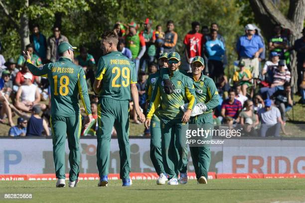 South Africa's team members celebrate a Bangladeshi wicket during the second one day international cricket match between South Africa and Bangladesh...