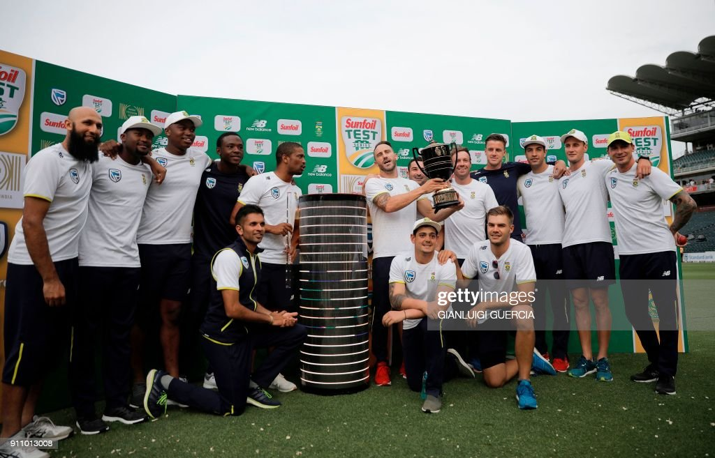 South Africa's team poses with the trophy after winning the three-match series 2-1 after the fourth day of the third Test match between South Africa and India at Wanderers cricket ground in Johannesburg on January 27, 2018. /