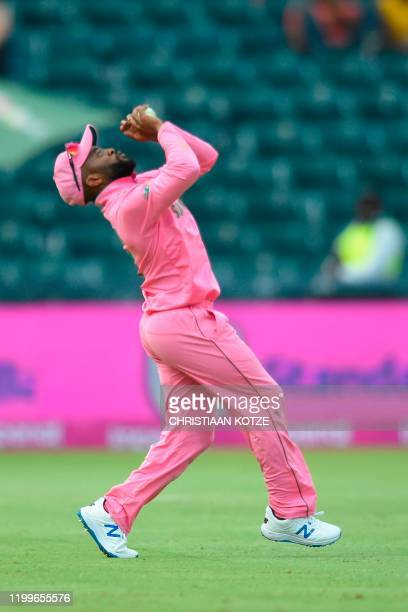 South Africa's Temba Bavuma catches out England's Tom Curran from a ball delivered by South Africa's Lungi Ngidi during the third one day...