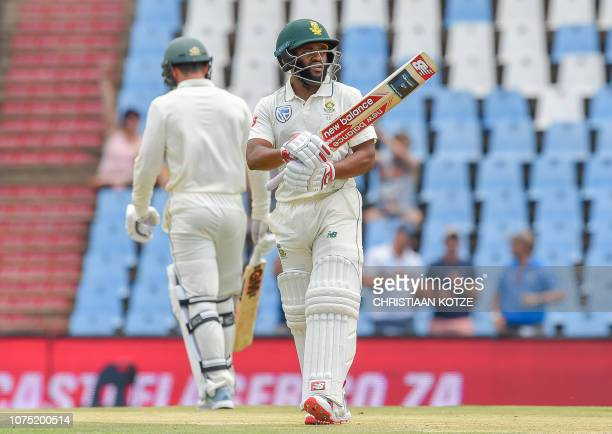 South Africa's Temba Bavuma celebrates after getting his fiftieth run during day two of the cricket test match between South Africa and Pakistan at...