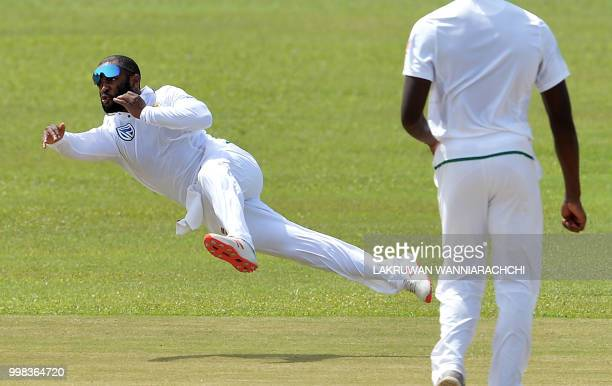South Africa's Temba Bavuma dives as he attempts to field a ball during the third day of the opening Test match between Sri Lanka and South Africa at...