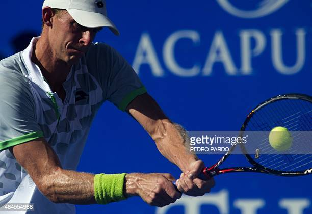 South Africa's tennis player Kevin Anderson returns the ball to Victor Troicki of Serbia during the Mexico ATP tournament in Acapulco, Guerrero...