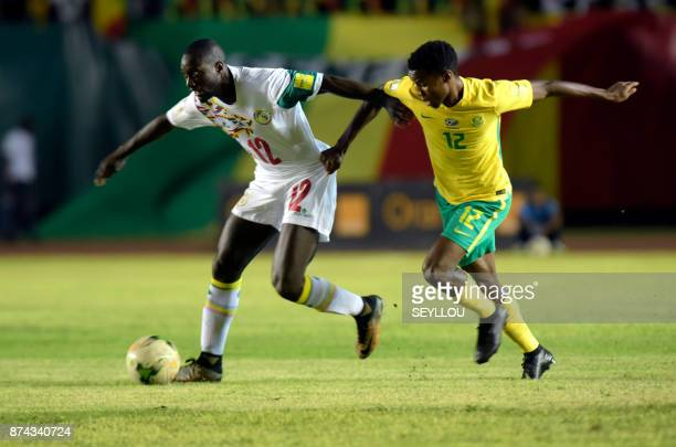 South Africa's Themb Zwane runs after the ball during the World Cup 2018 playoff football match between Senegal and South Africa at The Leopold Sedar...