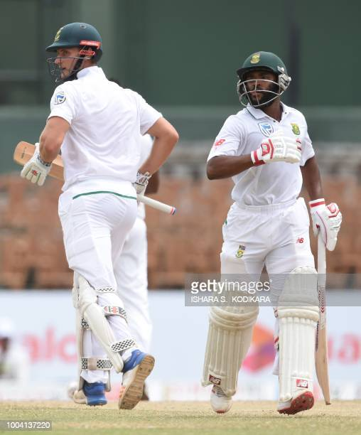 South Africa's Theunis de Bruyn and Temba Bavuma run between the wickets during the fourth day of the second Test match between Sri Lanka and South...