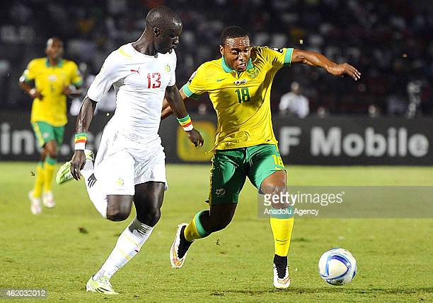 South Africa's Thuso Phala vies for ball with Senegal's Cheikh M'Bengu during the 2015 African Cup of Nations Group C football match between South...