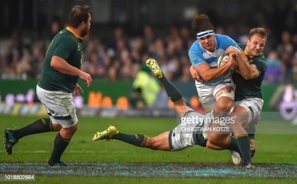 TOPSHOT South Africa's tight head prop Frans Malherbe looks on as Argentina's flanker Pablo Matera is tackled by South Africa's inside centre Andre...