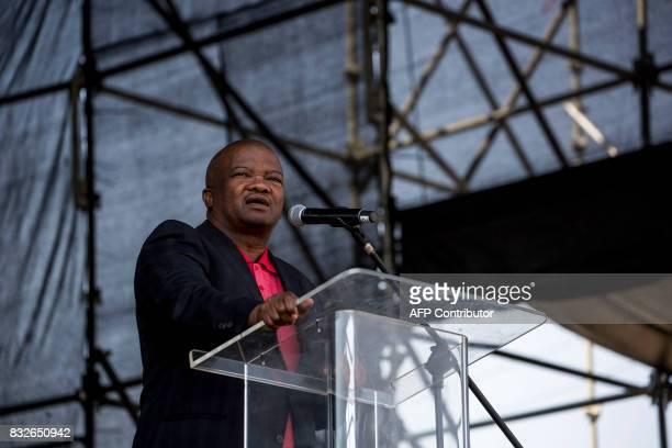 South Africa's United Democratic Movement party leader Bantu Holomisa addresses the crowd as members of the Association of Mineworkers and the...