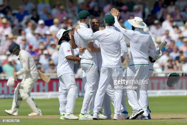 South Africa's Vernon Philander celebrates taking the wicket of England's Ben Stokes for 18 runs on the fourth day of the second Test match between...