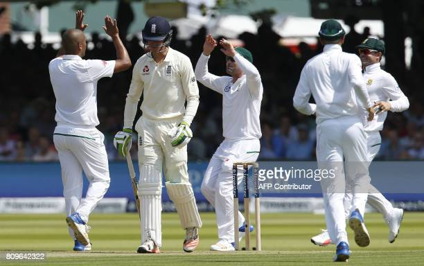 South Africa's Vernon Philander celebrates the wicket of Englands Keaton Jennings for eight runs during the first day of the first Test match between...