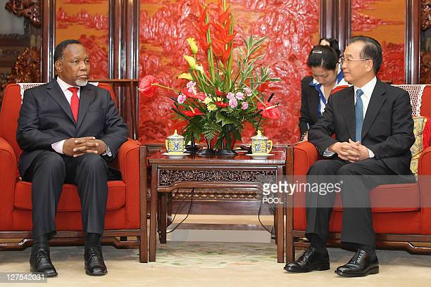 South Africa's Vice President Kgalema Motlanthe speaks to Chinese Premier Wen Jiabao during their meeting at Zhongnanhai in Beijing on September 29,...