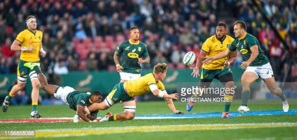 South Africas' Warrick Gelant tackles Australia's Michael Hooper during the 2019 Rugby Championship match, South Africa v Australia, at the Emirates...