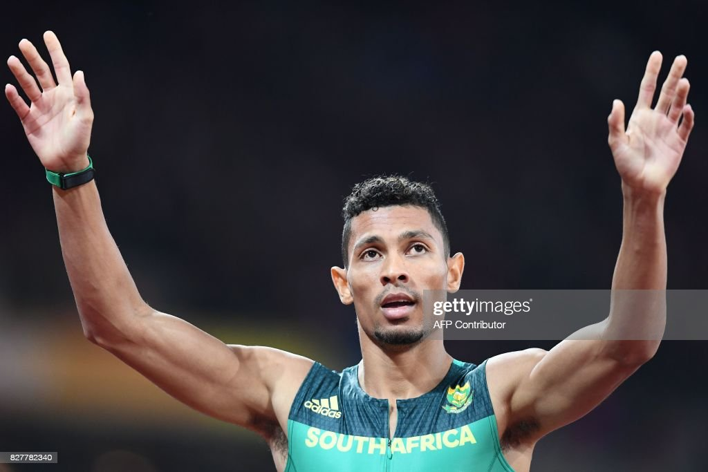 South Africa's Wayde Van Niekerk celebrates after winning the final of the men's 400m athletics event at the 2017 IAAF World Championships at the London Stadium in London on August 8, 2017. / AFP PHOTO / Jewel SAMAD