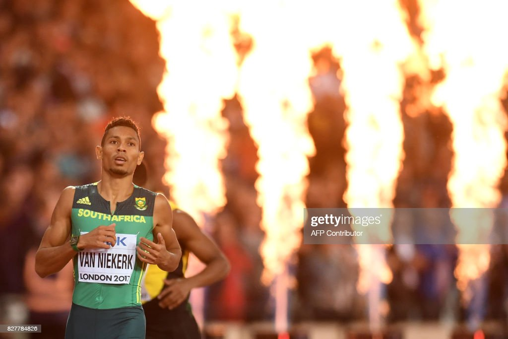 TOPSHOT - South Africa's Wayde Van Niekerk reacts after winning the final of the men's 400m athletics event at the 2017 IAAF World Championships at the London Stadium in London on August 8, 2017. / AFP PHOTO / Glyn KIRK