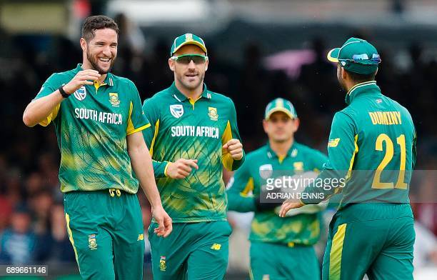 South Africa's Wayne Parnell celebrates with South Africa's JP Duminy after they took the wicket of England's David Willey for 26 runs during the...